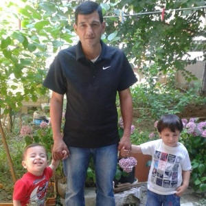 Syrian Abdullah Kurdi poses with his sons Aylan (left) and Galip. Aylan's body was found washed up on a beach in Turkey on Sept. 2, 2015 amid Europe's deepening migrant crisis. (Abdullah Kurdi via Facebook)